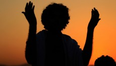 raising-hands-in-congregational-supplication-for-deceased-in-graveyard